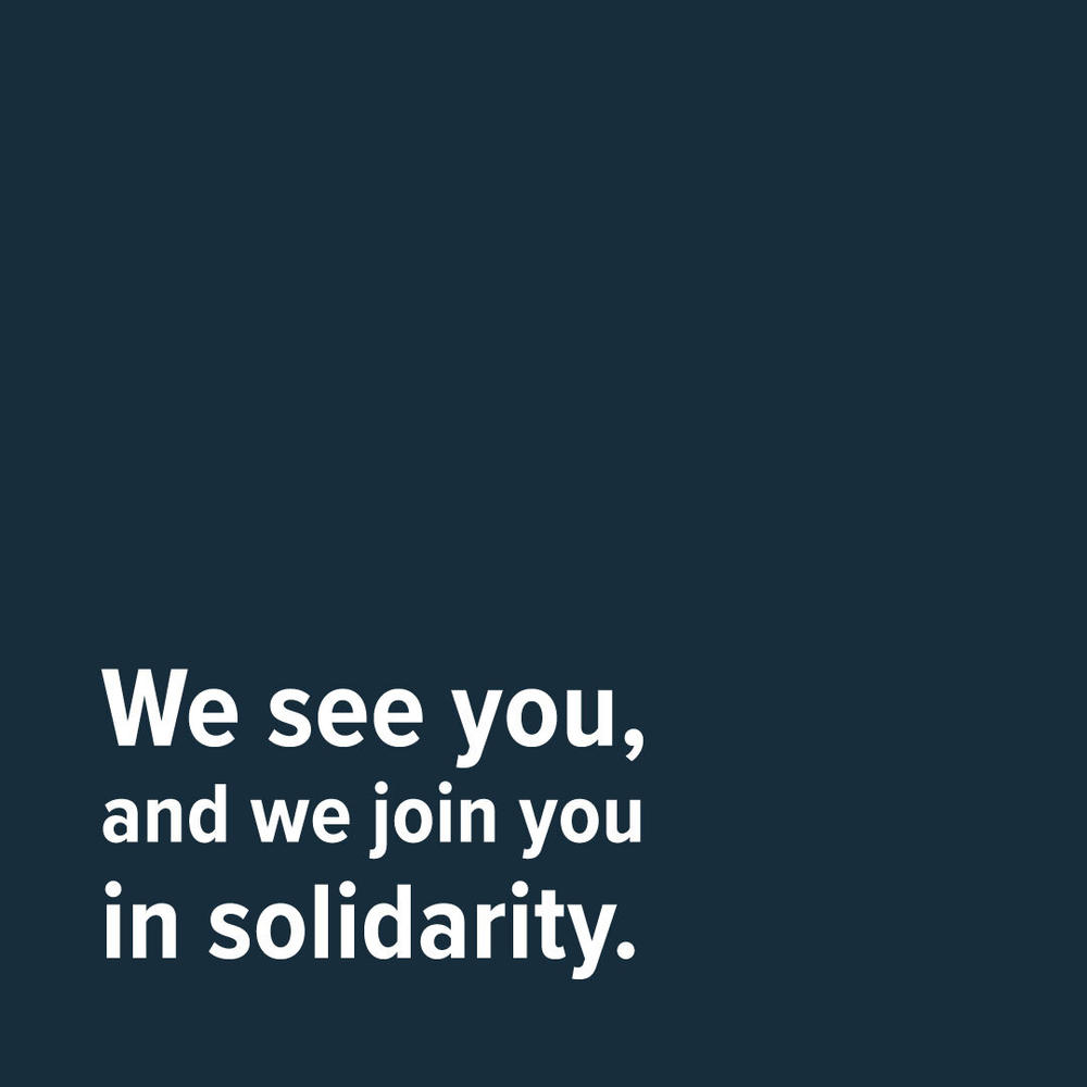 Dark Blue Square that says: We see you, and we join you in solidarity.